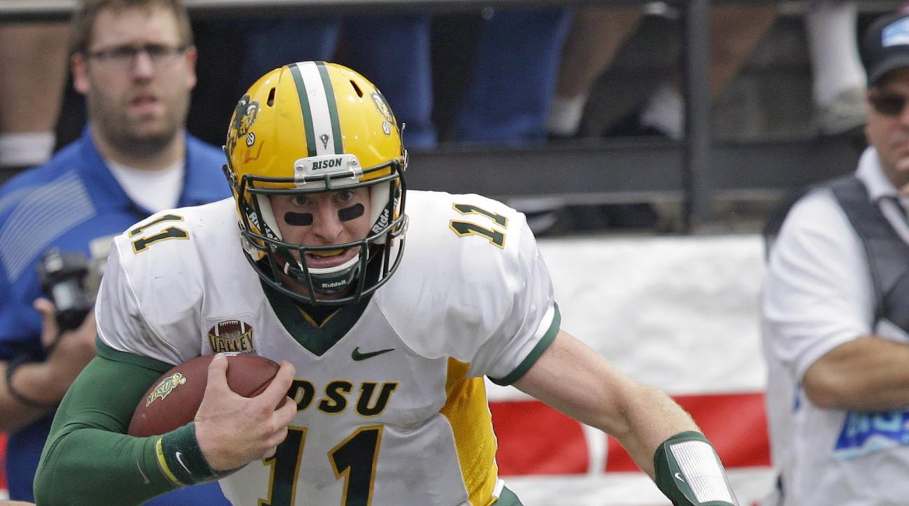North Dakota State quarterback Carson Wentz (11) runs for a touchdown during the first half of an NCAA college football game against Montana Saturday, Aug. 29, 2015, in Missoula, Mont.  (AP Photo/Rick Bowmer)