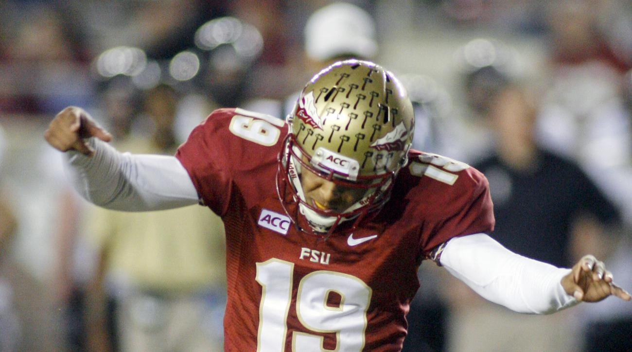 FILE - In this Nov. 23, 2013, file photo, Florida State kicker Roberto Aguayo (19) ties an FBC record of 78 consecutive extra points in a season with an extra point in the fourth quarter of an NCAA college football game against Idaho in Tallahassee, Fla.