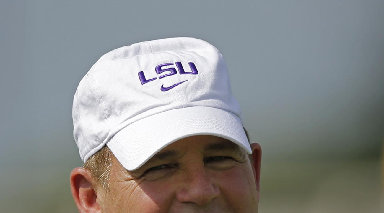 FILE - In this Aug. 7, 2015, file photo, LSU head coach Les Miles watches during NCAA college football practice in Baton Rouge, La. LSU officials say football coach Les Miles had to go to the hospital Monday morning, Aug. 31, 2015,  as a precaution after