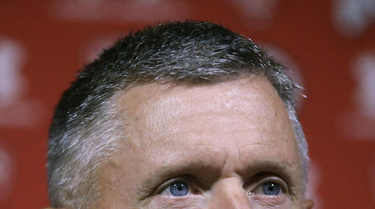 Utah NCAA college football coach Kyle Whittingham speaks during a news conference Monday, Aug. 31, 2015, in Salt Lake City. Jim Harbaugh and the Michigan Wolverines have been one of the biggest storylines headed into the 2015 college football season seaso