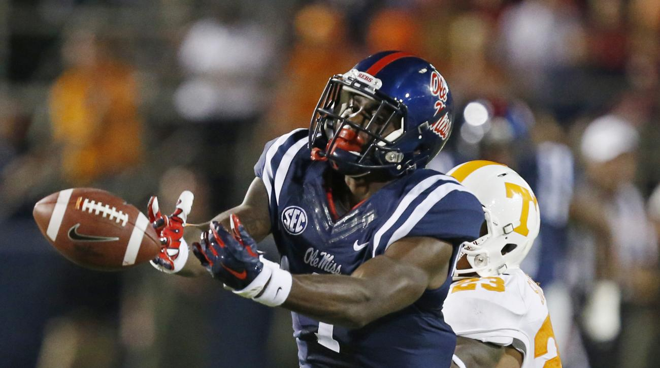 FILE - In this Oct. 18, 2014, Mississippi wide receiver Laquon Treadwell (1) lunges for a pass against the defense of Tennessee defensive back Cameron Sutton (23) in the first half of an NCAA college football game in Oxford, Miss. Mississippi coach Hugh F