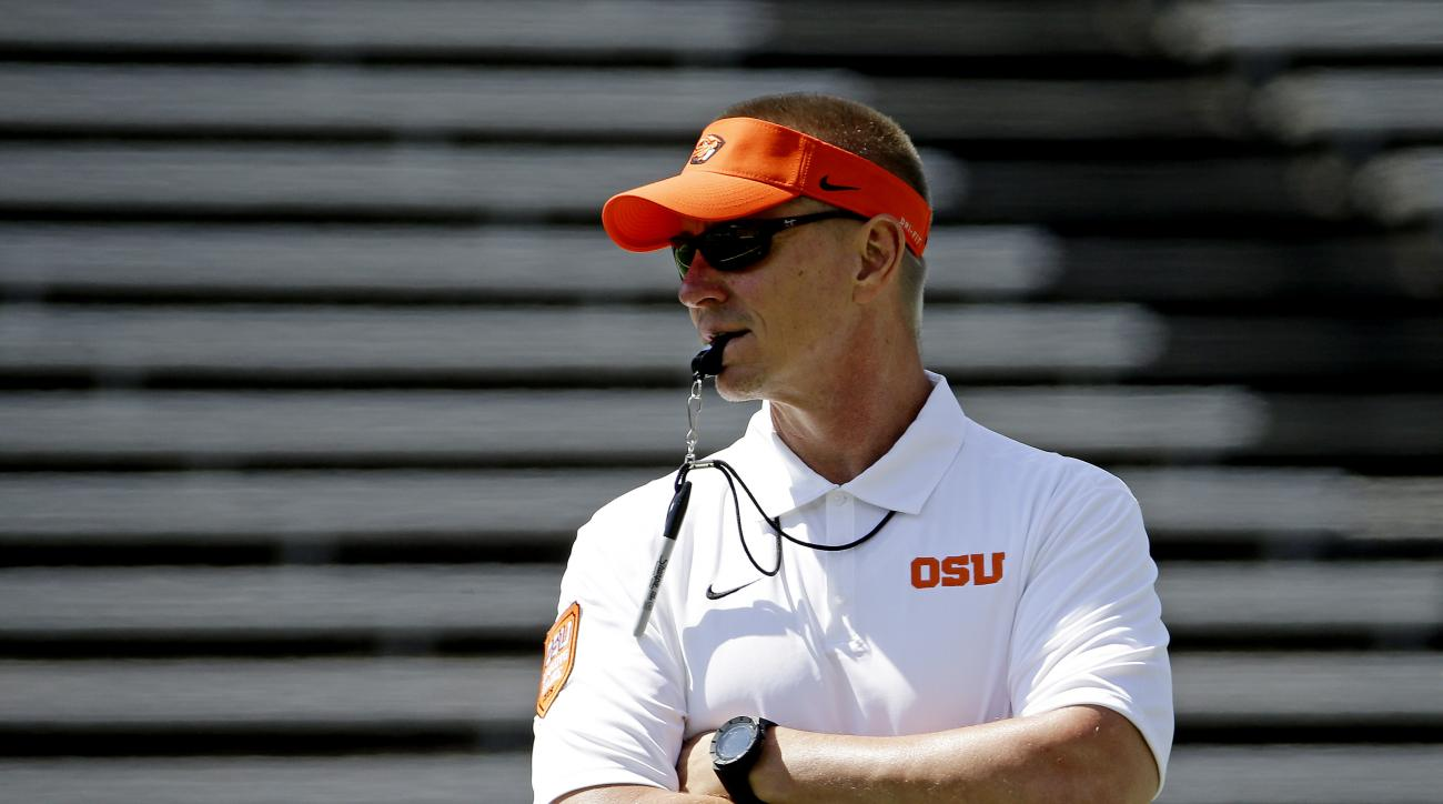 FILE - In this April 18, 2015, file photo, Oregon State football coach Gary Andersen watches during the first half of the NCAA college football team's spring game in Corvallis, Ore.  Andersen says that playing against Weber State  coach Jay Hill Friday fo