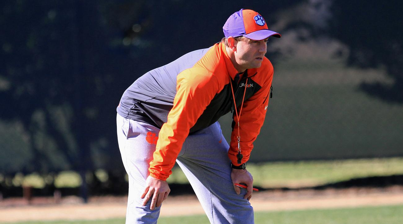FILE - In this Dec. 13, 2014, file photo, Clemson head coach Dabo Swinney watches an NCAA college football bowl practice session in Clemson, S.C. Swinney hopes the 12th ranked Tigers do not take things lightly when they start with FCS opponent Wofford thi