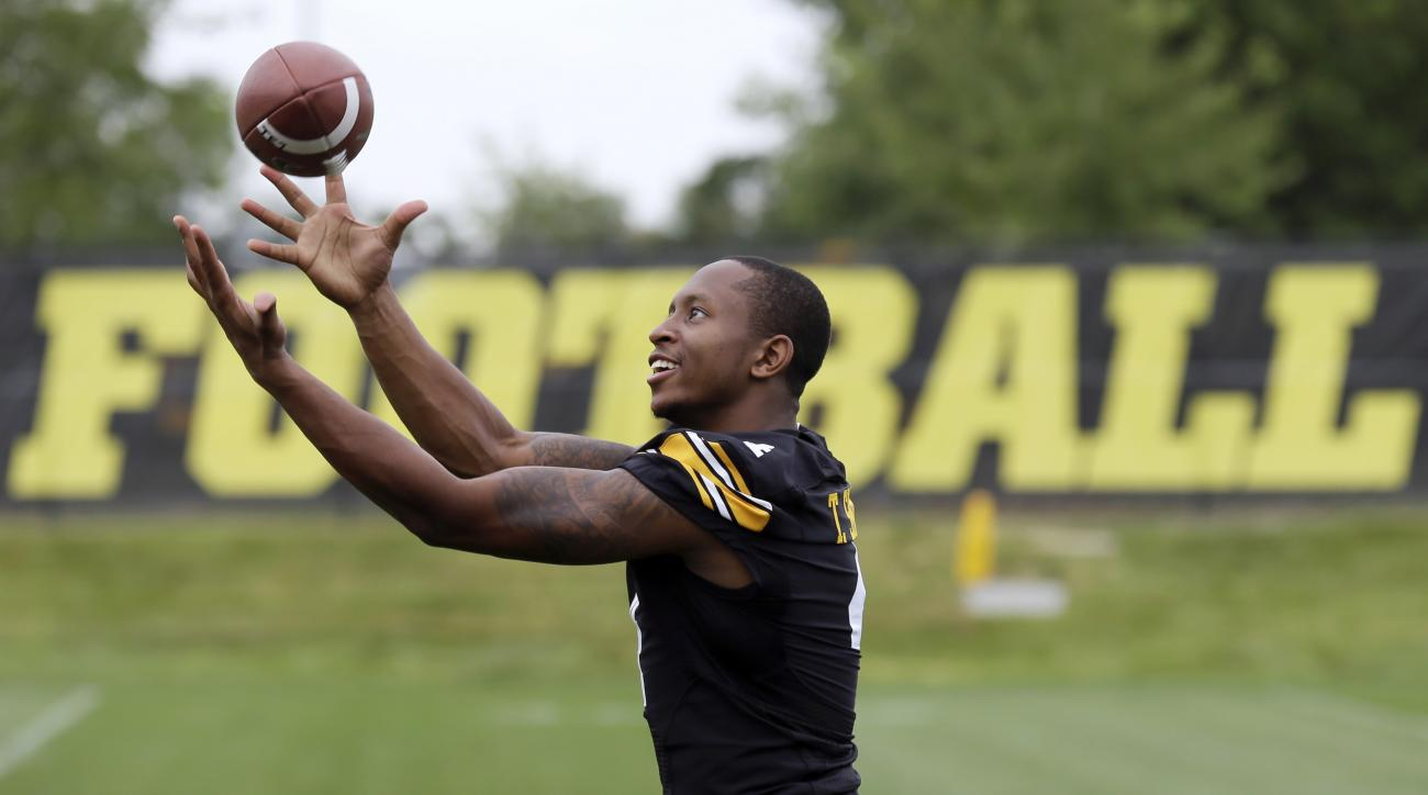 FILE - In this Aug. 8, 2015, file photo, Iowa wide receiver Tevaun Smith catches a pass during the NCAA college football team's media day in Iowa City, Iowa. Tevaun Smith made waves this offseason by catching 41 passes in 60 seconds with just one hand for
