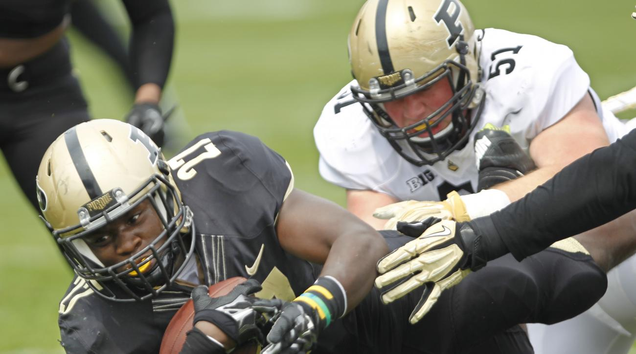 FILE - In this April 18, 2015, file photo, Purdue's D.J. Knox dives for a touchdown for the Black team in the Gold & Black spring NCAA college football game in West Lafayette, Ind. Knox and Markell Jones will get a chance to show what they can do in their