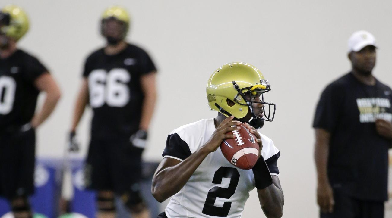 FILE - In this Aug. 6, 2015, file photo, Vanderbilt quarterback Johnny McCrary looks to pass during NCAA college football practice in Nashville, Tenn. The Commodores are keeping their starting quarterback a secret until the first series of their opener Th