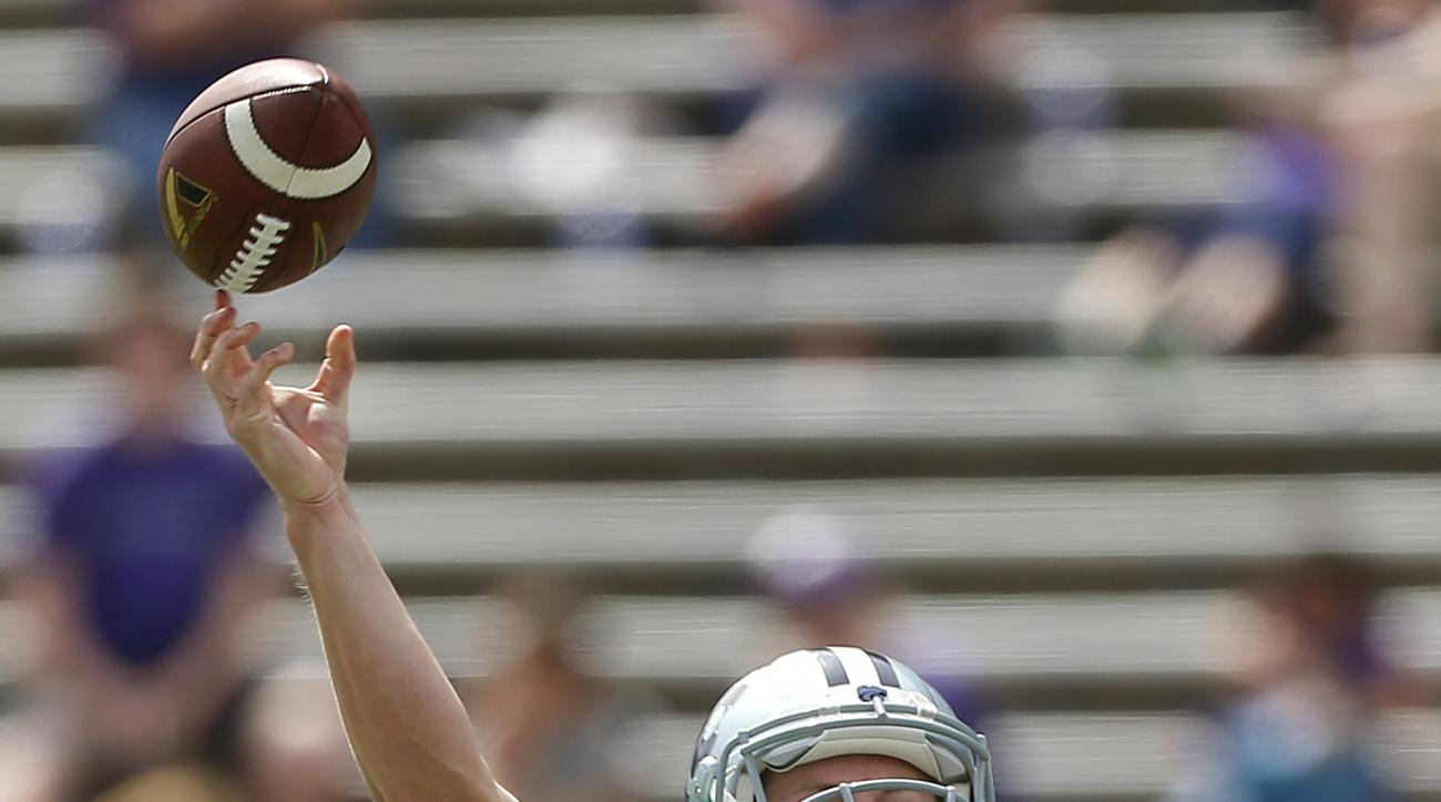 FILE - In this April 26, 2014, file photo, Kansas State quarterback Jesse Ertz throws downfield during the second half of an NCAA college spring football game in Manhattan, Kan. Ertz has won a four-way competition to start at quarterback Saturday in the s