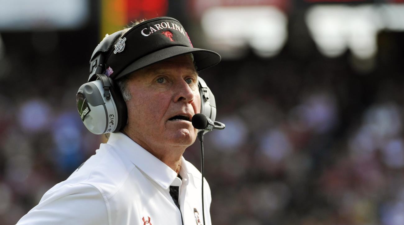 FILE - In this Nov. 2, 2013 file photo, South Carolina head coach Steve Spurrier looks on during the first half of an NCAA college football game against Mississippi State. North Carolina has overhauled its defensive coaching staff and scheme after giving