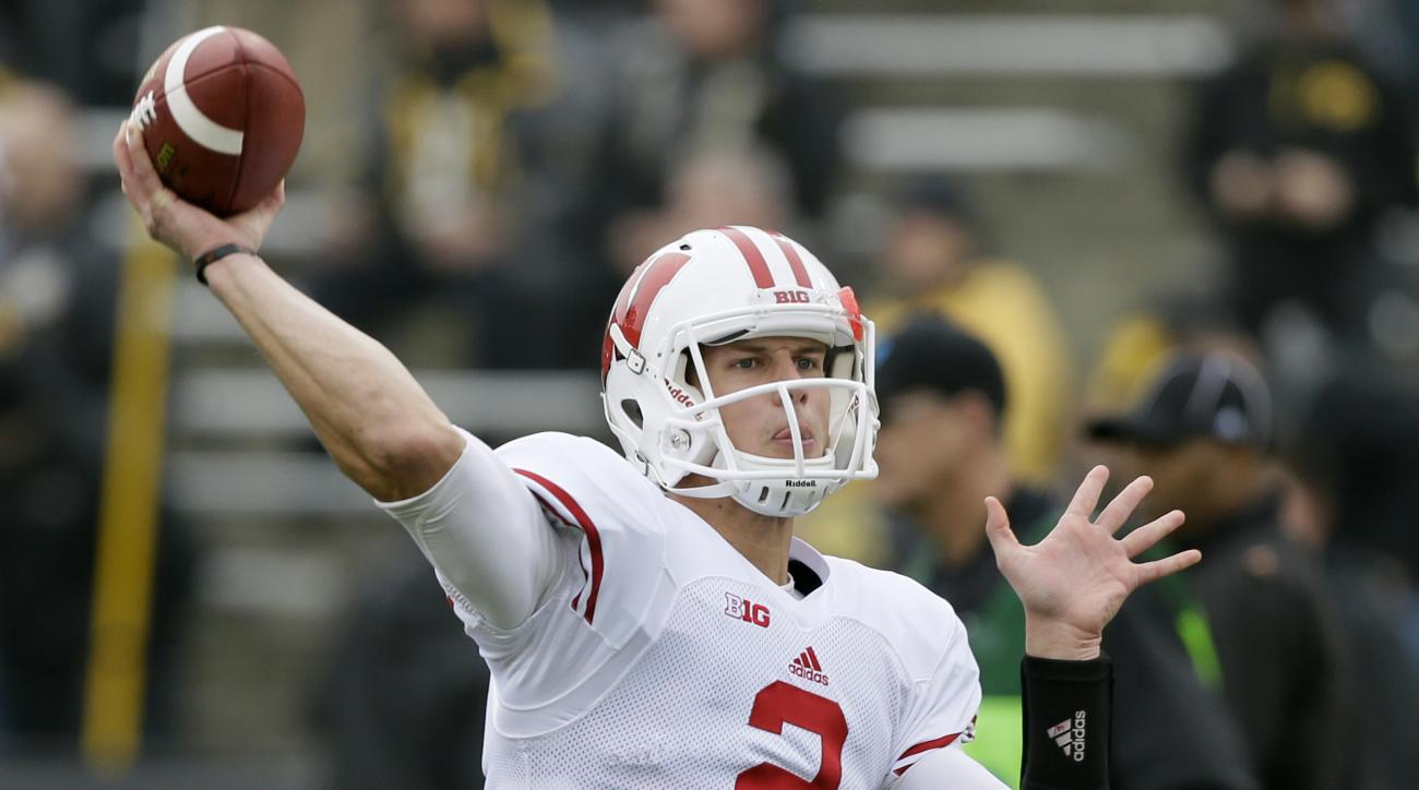 FILE - In this Nov. 22, 2014, file photo, Wisconsin quarterback Joel Stave warms up before an NCAA college football game against Iowa in Iowa City, Iowa. This time last year, quarterback Joel Stave wasn't having much fun. He has a whole new outlook now th