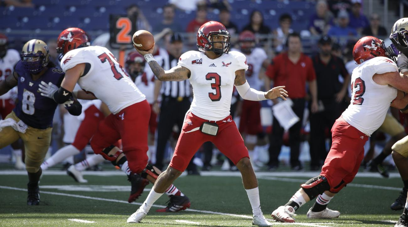 FILE - In this Sept. 6, 2014, file photo, Eastern Washington quarterback Vernon Adams Jr. throws against Washington Huskies in the second half of an NCAA football game in Seattle.  It's not lost on Oregon that Vernon Adams' first game for the them wil