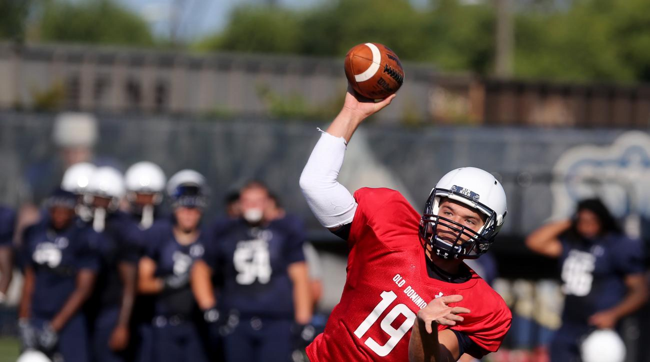 In this photo taken on Monday, Aug. 29, 2015, Old Dominion University quarterback Shuler Bentley throws a pass during a practice, in Norfolk, Va. Bentley spent last season watching, and learning from, Taylor Heinicke at Old Dominion. Now, with the prolifi