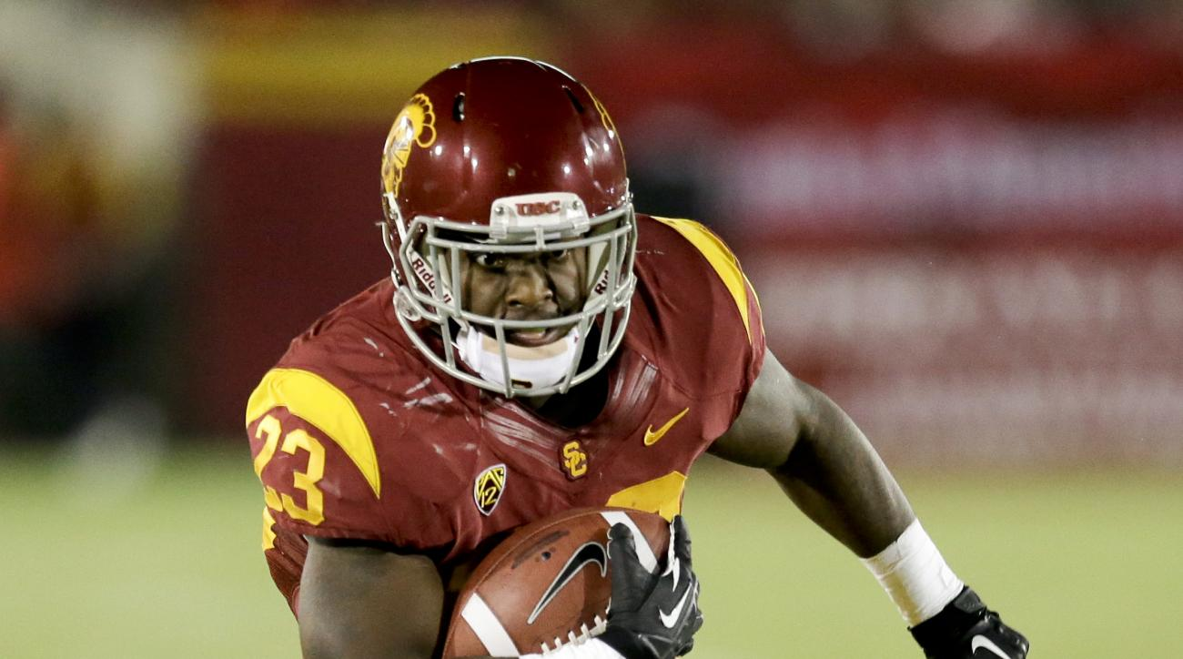 FILE - In this Sept. 7, 2013, file photo, Southern California running back Tre Madden runs against Washington State during an NCAA college football game in Los Angeles. Madden never lost faith in his ability and durability while missing two of the last th