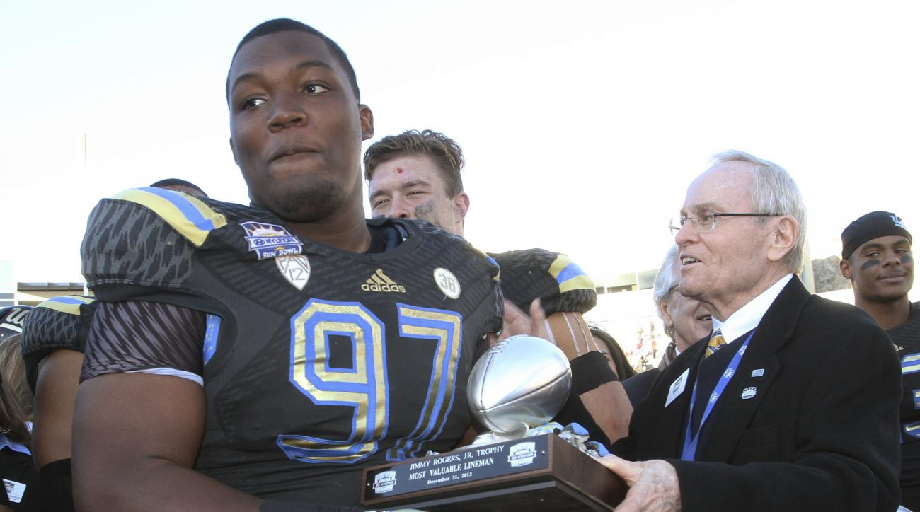 FILE - In this Dec. 31, 2013, file photo, UCLA's Kenny Clark is presented the Most Valuable Lineman trophy after UCLA defeated Virginia Tech 42-12 in an NCAA college football game in El Paso, Texas. Clark, a run-stuffing defensive tackle, has evolved into