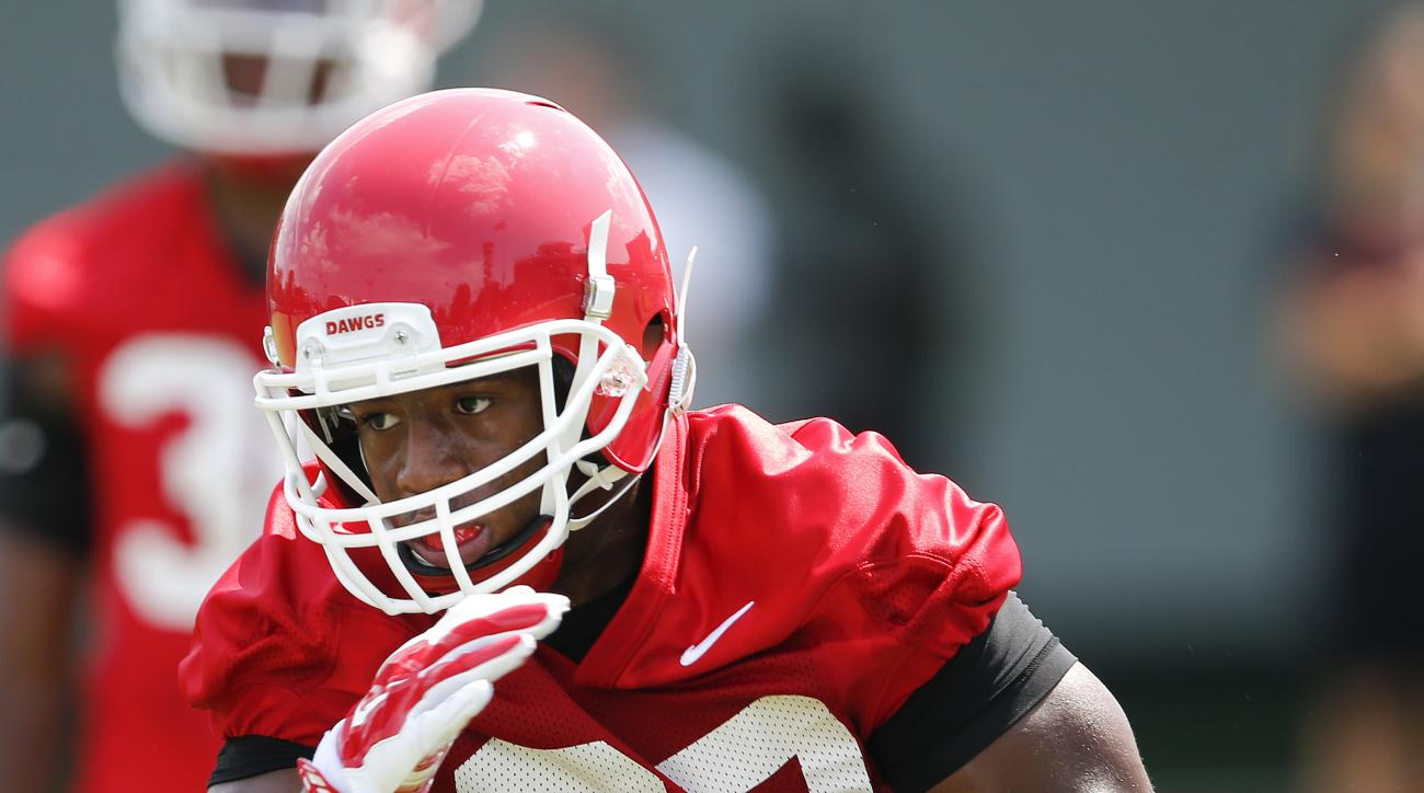 FILE - In this Aug. 4, 2015, file photo, Georgia running back Nick Chubb runs the ball during an NCAA college football practice in Athens, Ga. One year ago, Chubb didn't know if he'd even get a carry in Georgia's opening game. Now, as he is set to start t