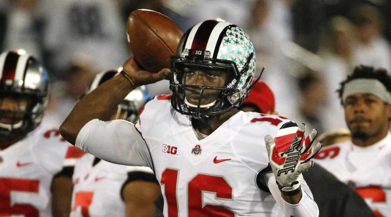 FILE - In this Oct. 25, 2014, file photo, Ohio State quarterback J.T. Barrett (16) warms up before an NCAA college football game against Penn State in State College, Pa. Urban Meyer will either start the Big Ten player of the year (J.T. Barrett) or the gu