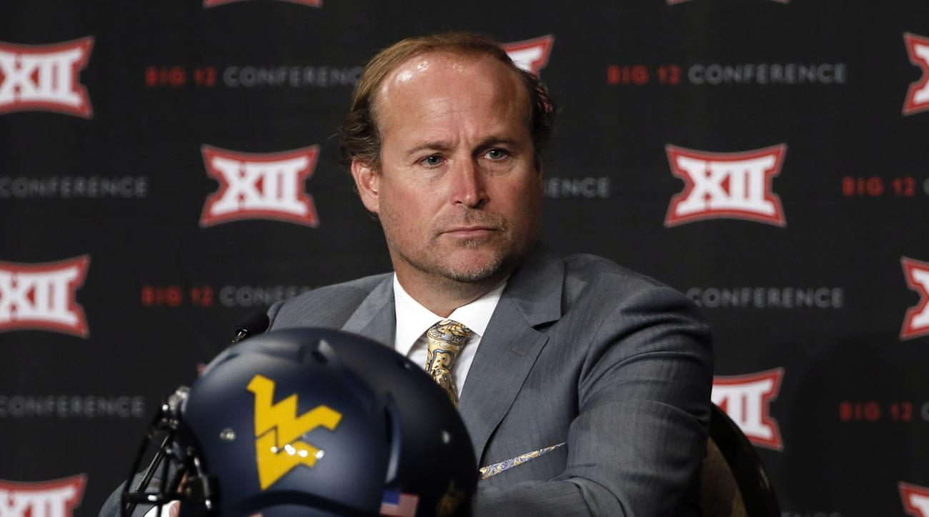 FILE - In this July 20, 2015, file photo, West Virginia head football coach Dana Holgorsen addresses attendees at Big 12 Conference Football Media Days in Dallas. West Virginia will host Georgia Southern in their season opener Saturday, Sept. 5, 2015, in