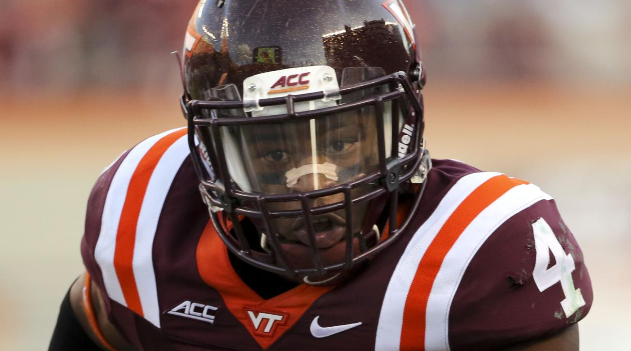 FILE - This Aug. 30 2014 file photo shows Virginia Tech running back J.C. Coleman scoring a touchdown in the fourth quarter against William & Mary during an NCAA college football game in Blacksburg Va. Coleman was almost written off as a tailback option a