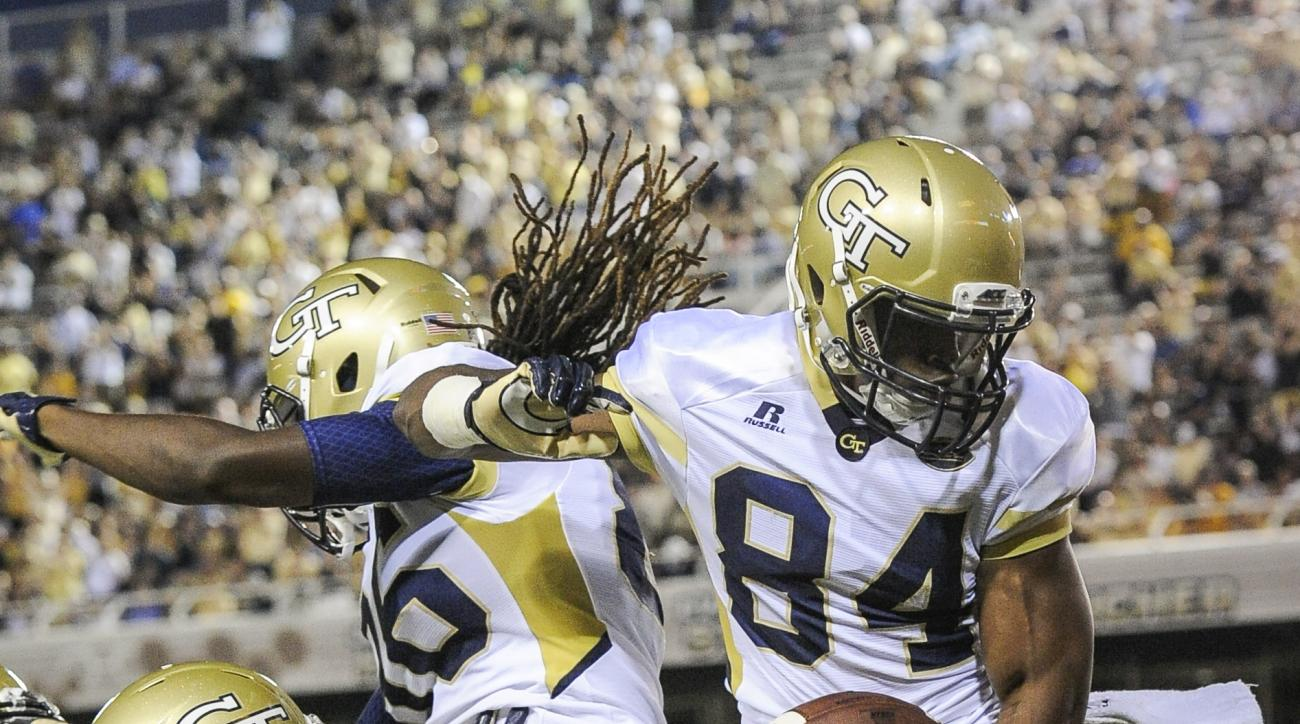 Georgia Tech wide receiver Micheal Summers (84) celebrates his touchdown reception with wide receiver Antonio Messick (86) and running back Clinton Lynch (49) during the first quarter of an NCAA college football game against Alcorn State, Thursday, Sept.