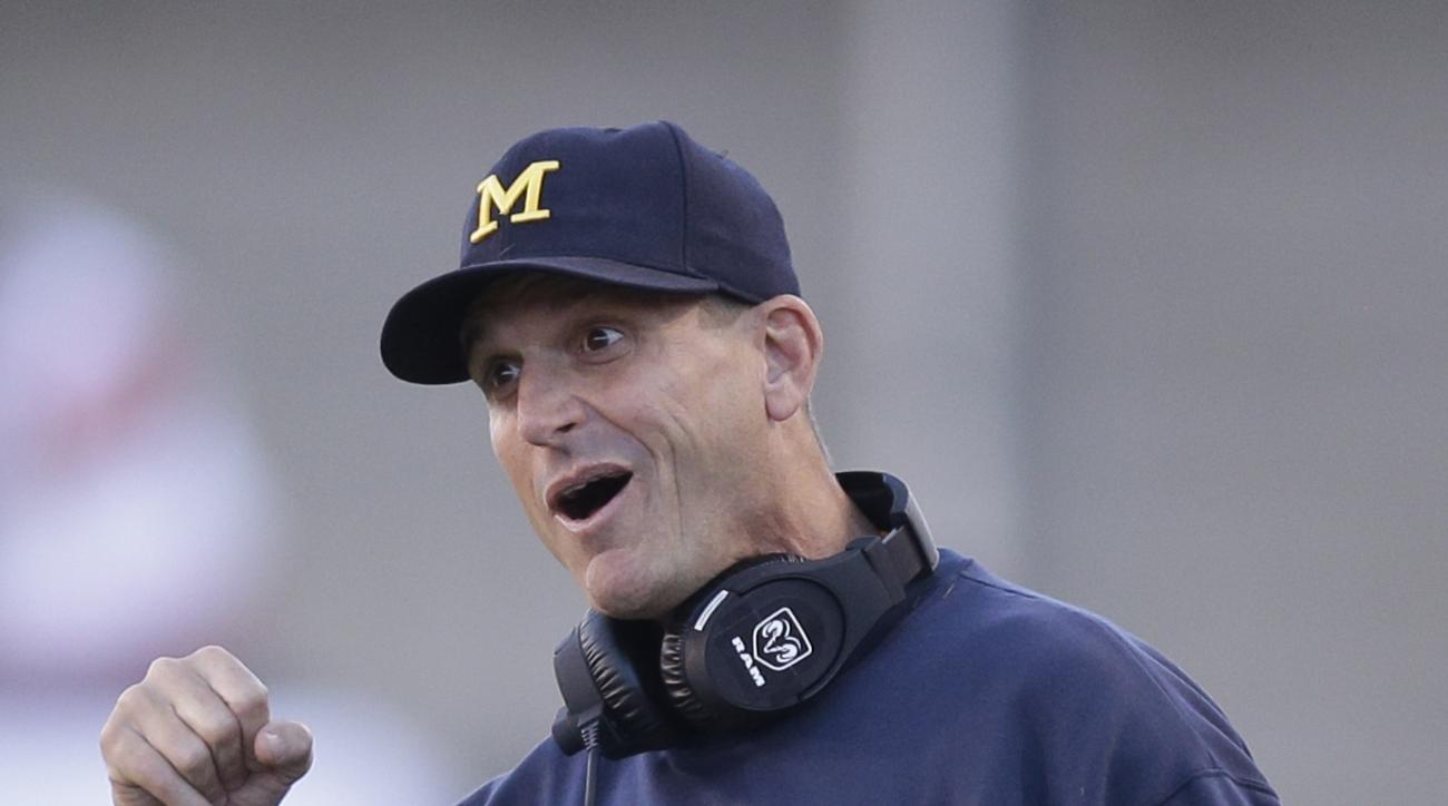 Michigan head coach Jim Harbaugh shouts to his team during the first quarter during an  NCAA college football game against Utah, Thursday, Sept. 3, 2015, in Salt Lake City. (AP Photo/Rick Bowmer)