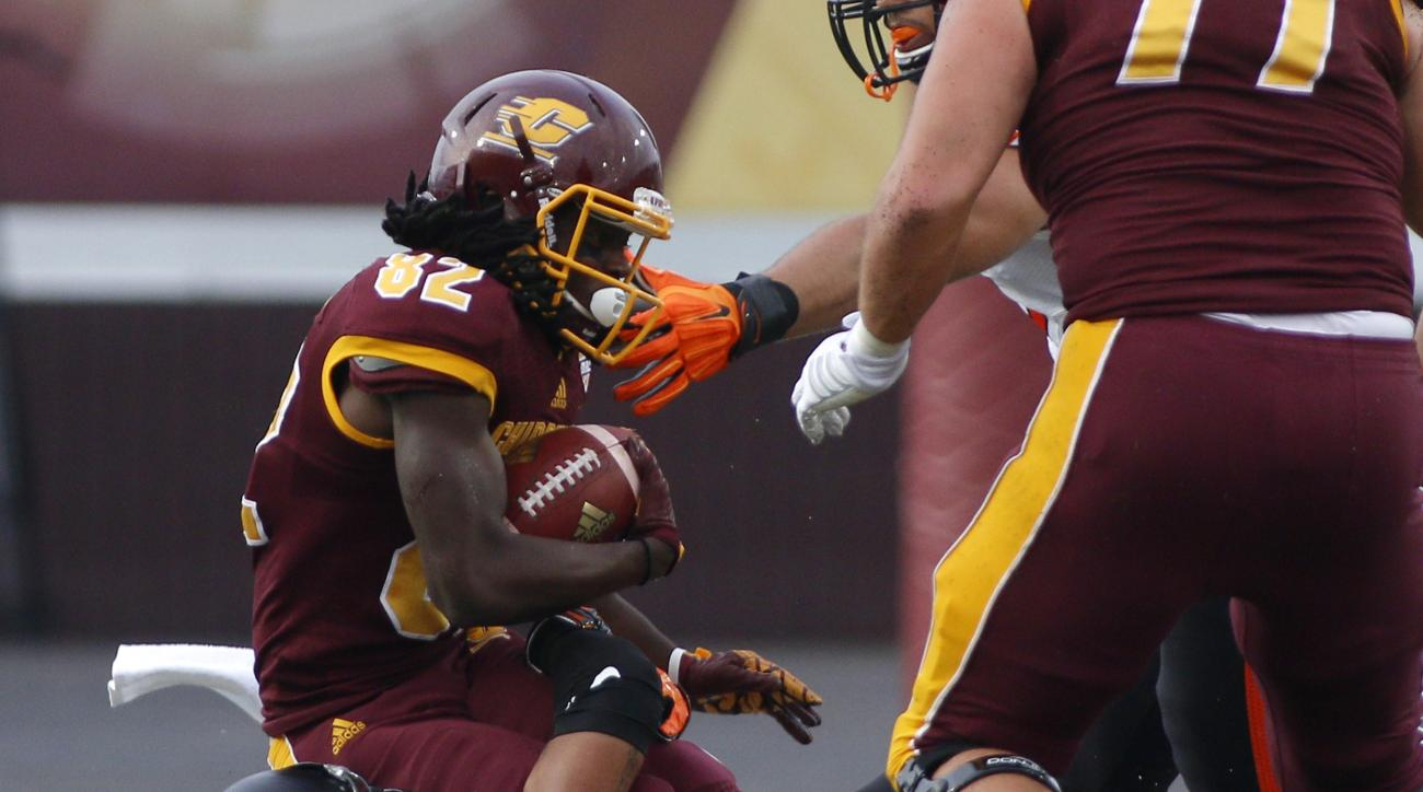 Central Michigan receiver Corey Willis, top, is stopped by Oklahoma State safety Jordan Sterns during the first quarter of an NCAA college football game, Thursday, Sept. 3, 2015, in Mount Pleasant, Mich. (AP Photo/Al Goldis)