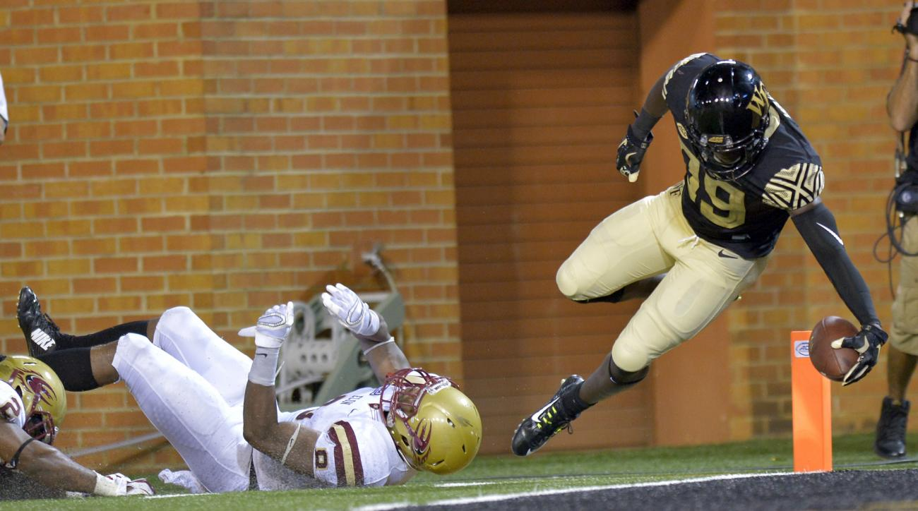 Wake Forest wide receiver Chuck Wade (89) eludes Elon defensive back Chris Blair (8) for a touchdown reception during the second half of an NCAA college football game, Thursday, Sept. 3, 2015, in Winston-Salem, N.C. (Bruce Chapman/The Winston-Salem Journa