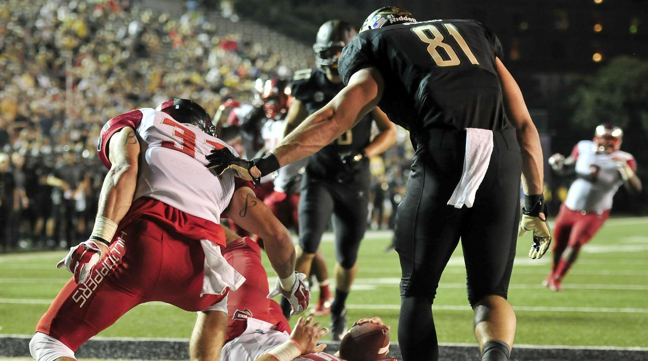 Western Kentucky linebacker Nick Holt (10) reacts after intercepting a pass intended for Vanderbilt tight end Steven Scheu (81) in the end zone during the second quarter of an NCAA college football game in Nashville, Tenn., Thursday, Sept. 3, 2015. Wester