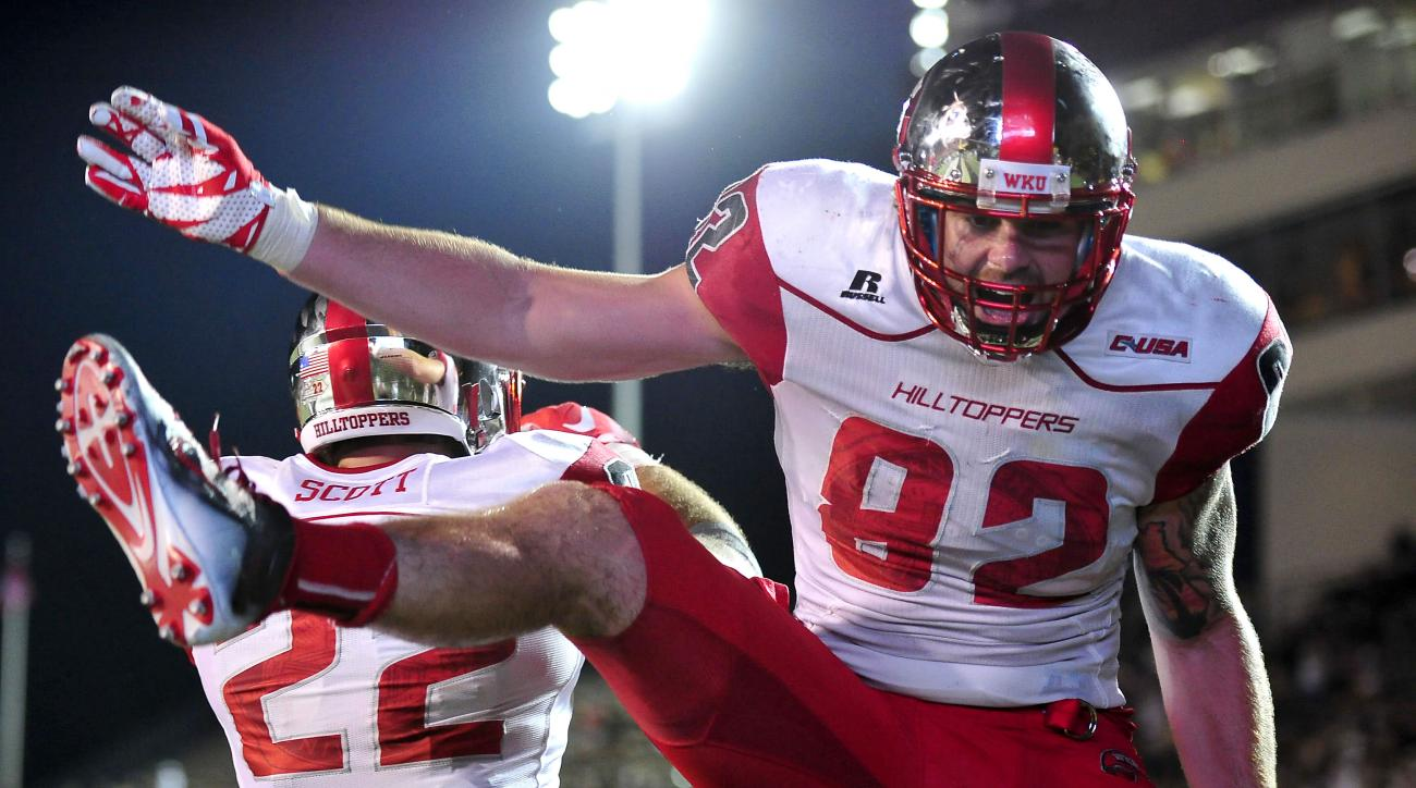 Western Kentucky tight end Tyler Higbee (82) celebrates with tight end Devin Scott (22) after scoring a touchdown against Vanderbilt during the fourth quarter of an NCAA college football game in Nashville, Tenn., Thursday, Sept. 3, 2015. Western Kentucky