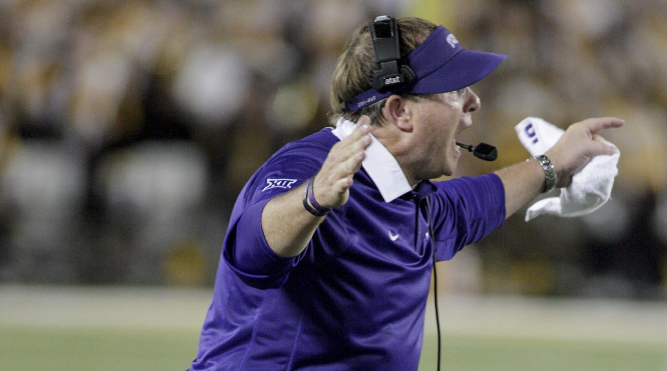 TCU head coach Gary Patterson yells to his team during the second half of an NCAA college football game against Minnesota on Thursday, Sept. 3, 2015, in Minneapolis. TCU won 23-17. (AP Photo/Paul Battaglia)
