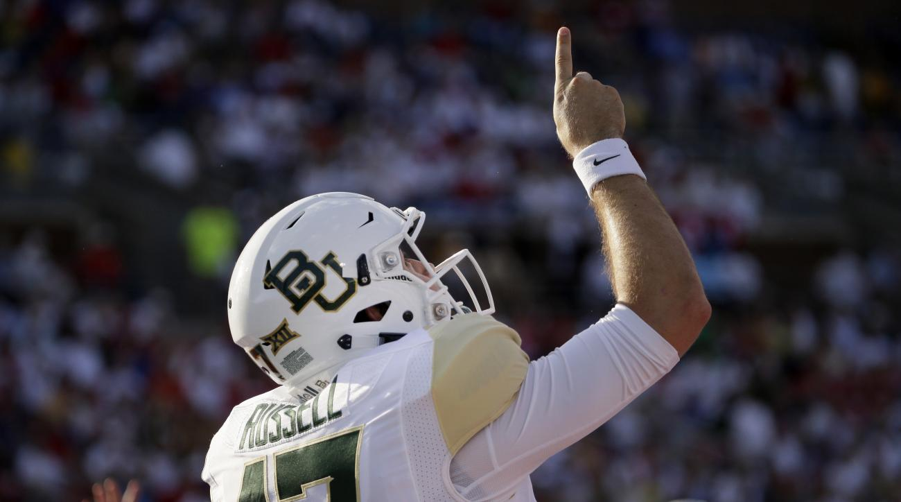 Baylor quarterback Seth Russell celebrates running in for a touchdown during the first half of an NCAA college football game against SMU, Friday, Sept. 4, 2015, in Dallas. (AP Photo/LM Otero)