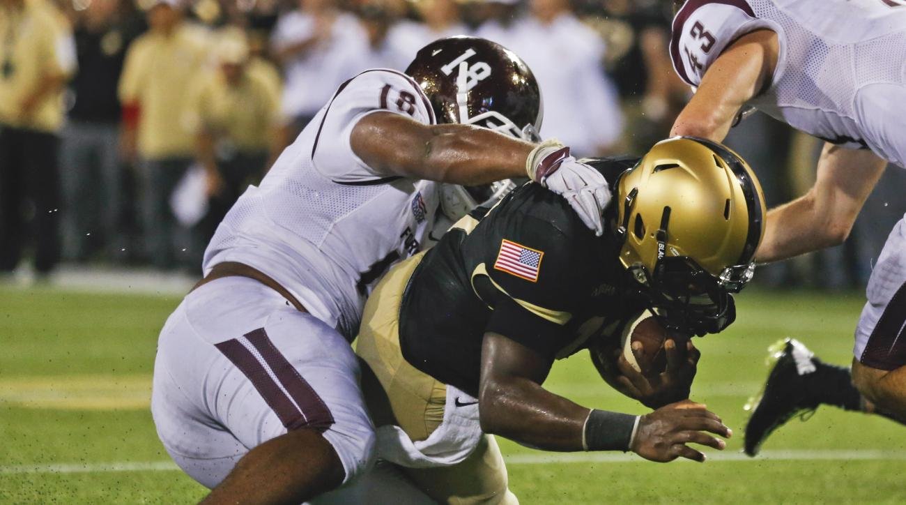 Army quarterback Ahmad Bradshaw dives past Fordham linebacker Niko Thorpe (18) for a 2-point conversion during the second half of an NCAA college football game Friday, Sept. 4, 2015, in West Point, N.Y. (AP Photo/Mike Groll)