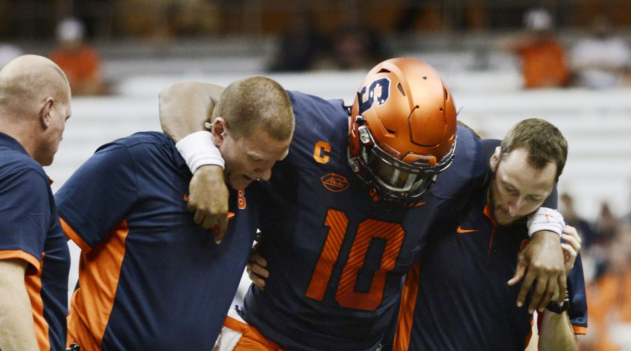 Syracuse's Terrel Hunt, 10, is carried off the field after injuring his heel during an NCAA college football game against Rhode Island, Friday, Sept. 4, 2015, at the Carrier Dome in Syracuse, N.Y. (AP Photo/Heather Ainsworth)