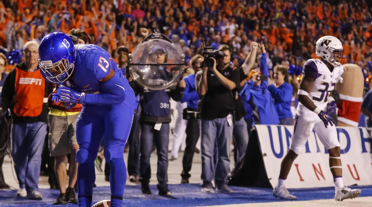 Boise State running back Jeremy McNichols (13) celebrates after a touchdown during the first half of an NCAA college football game against Washington in Boise, Idaho, on Friday, Sept. 4, 2015. (AP Photo/Otto Kitsinger)