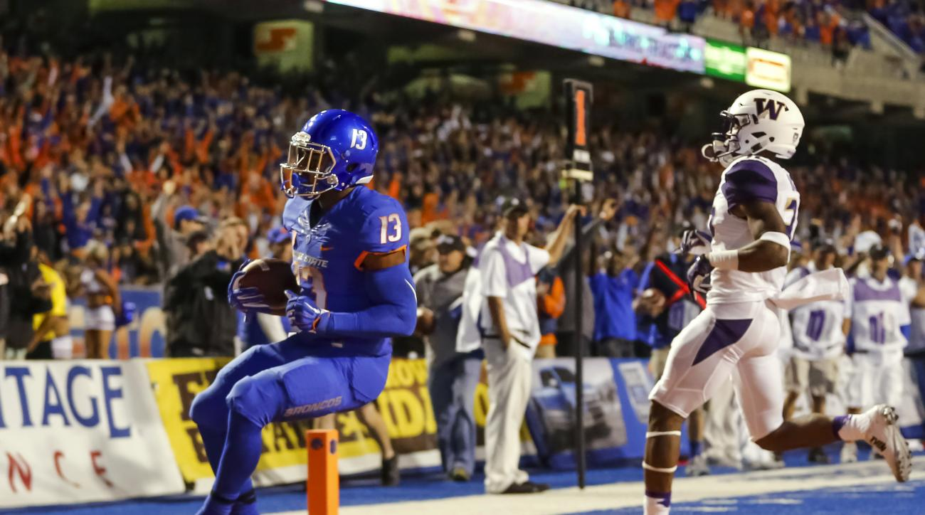 Boise State running back Jeremy McNichols (13) runs for a touchdown during the first half of an NCAA college football game against Washington in Boise, Idaho, on Friday, Sept. 4, 2015. (AP Photo/Otto Kitsinger)