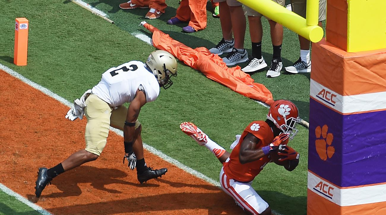 Clemson wide receiver Mike Williams (7) catches a pass out of the end zone as Wofford cornerback Chris Armfield (2) defends during the first half of an NCAA college football game, Saturday, Sept. 5, 2015, in Clemson, S.C.  Williams was injured on the play