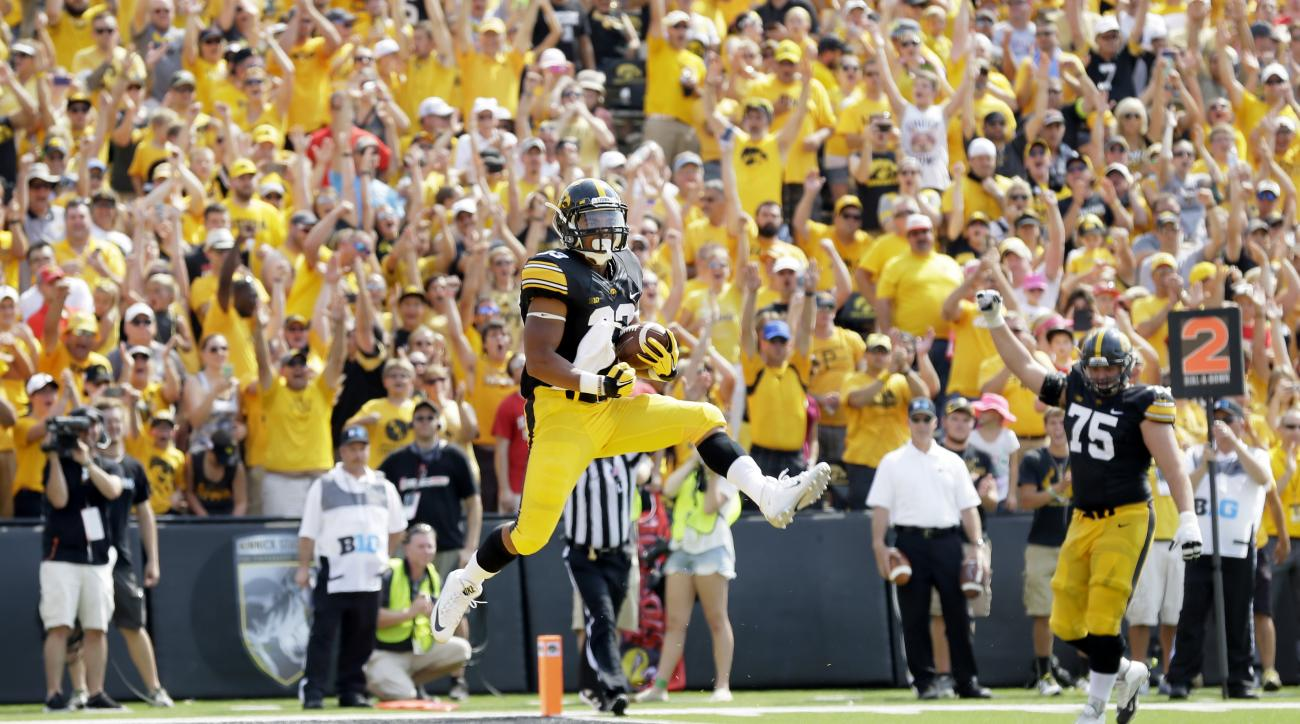 Iowa running back Jordan Canzeri celebrates after scoring on a 5-yard touchdown run during the first half of an NCAA college football game against Illinois State, Saturday, Sept. 5, 2015, in Iowa City, Iowa. (AP Photo/Charlie Neibergall)