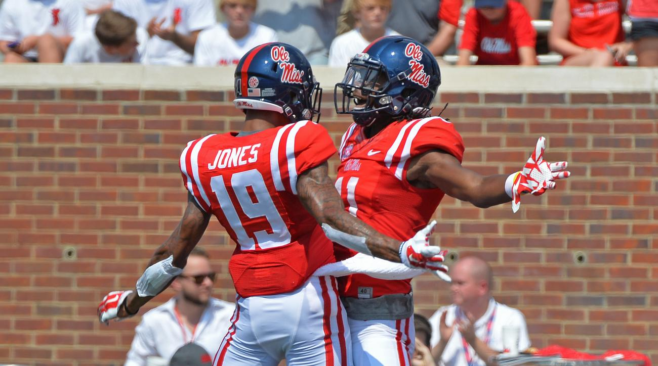 Mississippi wide receivers Derrick Jones (19) and Markell Pack (11)  celebrate after Pack's 56-yard touchdown catch during the first quarter of an NCAA college football game against Tennessee-Martin in Oxford, Miss., Saturday, Sept. 5, 2015. (AP Photo/Tho