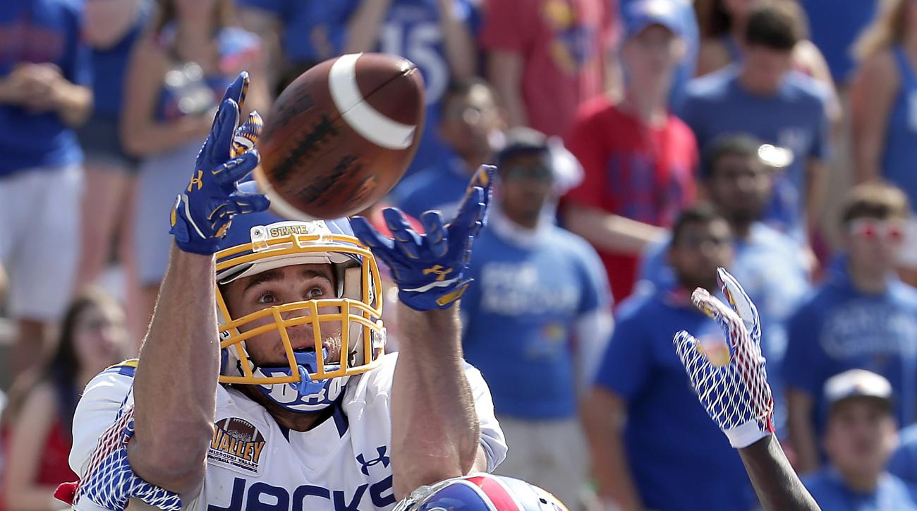 South Dakota State wide receiver Jake Wieneke (19) catches a 19 yard pass under pressure from Kansas cornerback Brandon Stewart (8) for a touchdown during the first half of an NCAA college football game Saturday, Sept. 5, 2015, in Lawrence, Kan. (AP Photo