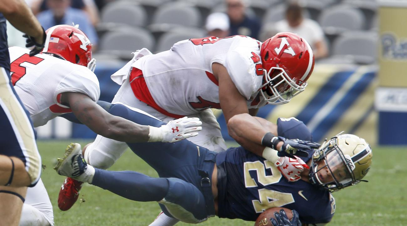 Youngstown State linebacker Jaylin Kelly (40) tackles Pittsburgh running back James Conner (24) in the second quarter of an NCAA college football game, Saturday, Sept. 5, 2015, in Pittsburgh. (AP Photo/Keith Srakocic)