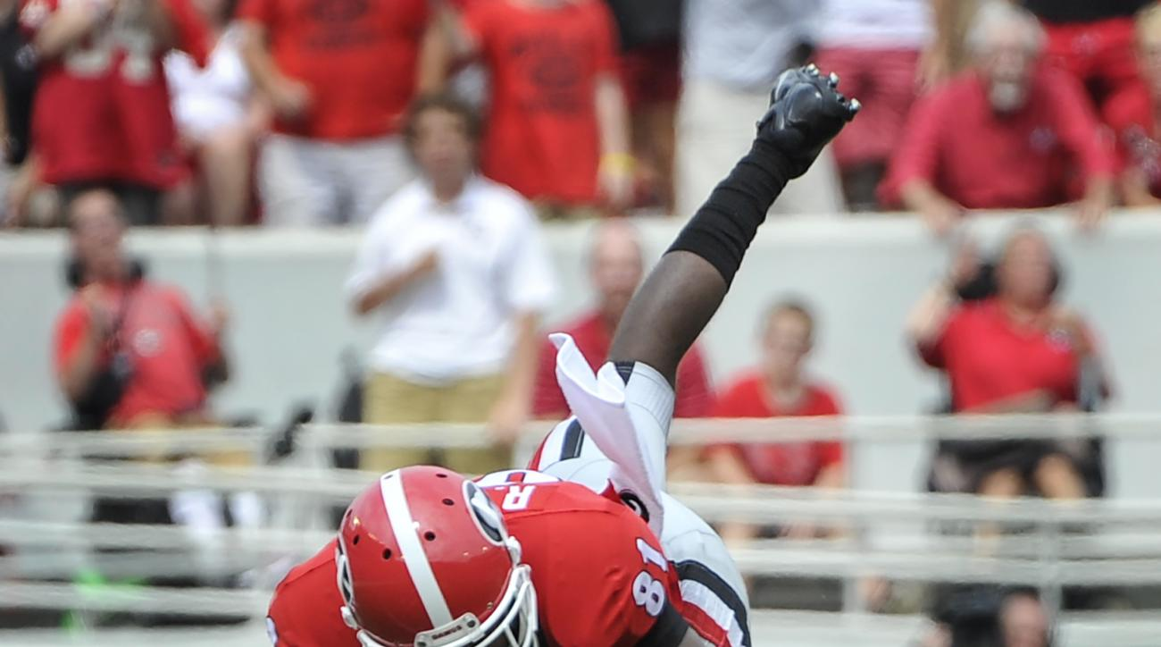 Georgia wide receiver Reggie Davis (81) is upended by Louisiana Monroe's Harley Scioneaux (88 ) during the first quarter of an NCAA college football game, Saturday, Sept., 5, 2015, in Athens, Ga. (AP Photo/John Amis)