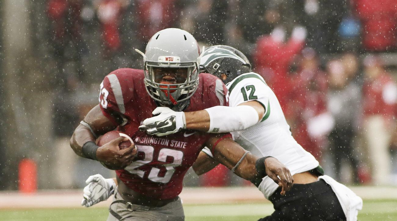 Washington State running back Gerard Wicks (23) runs against Portland State safety Walter Santiago (12) during the first half of an NCAA college football game, Saturday, Sept. 5, 2015, in Pullman, Wash. (AP Photo/Young Kwak)