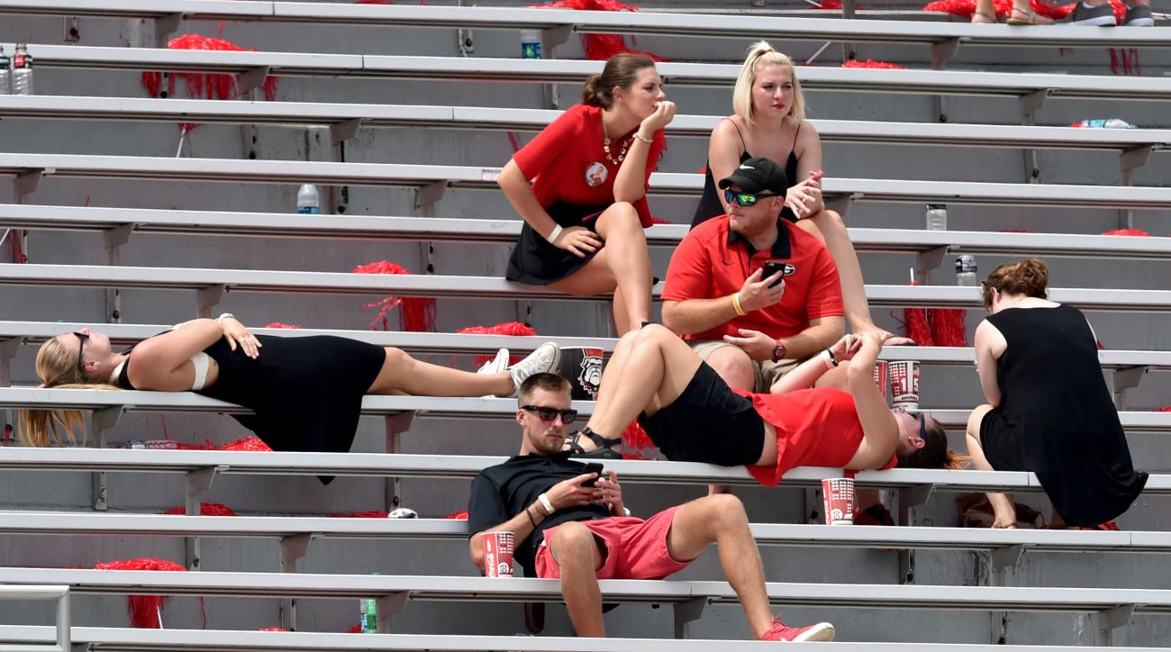 Georgia fans wait out a weather delay during an NCAA college football game between Georgia and Louisiana Monroe at Sanford Stadium in Athens, Ga., Saturday, Sept. 5, 2015. (Brant Sanderlin/Atlanta Journal-Constitution via AP)  MARIETTA DAILY OUT; GWINNETT