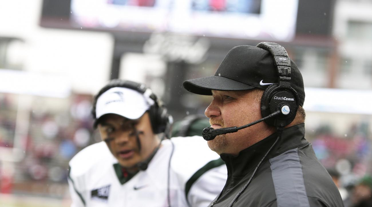 Portland State head coach Bruce Barnum, right, watches during the first half of an NCAA college football game against Washington State, Saturday, Sept. 5, 2015, in Pullman, Wash. (AP Photo/Young Kwak)