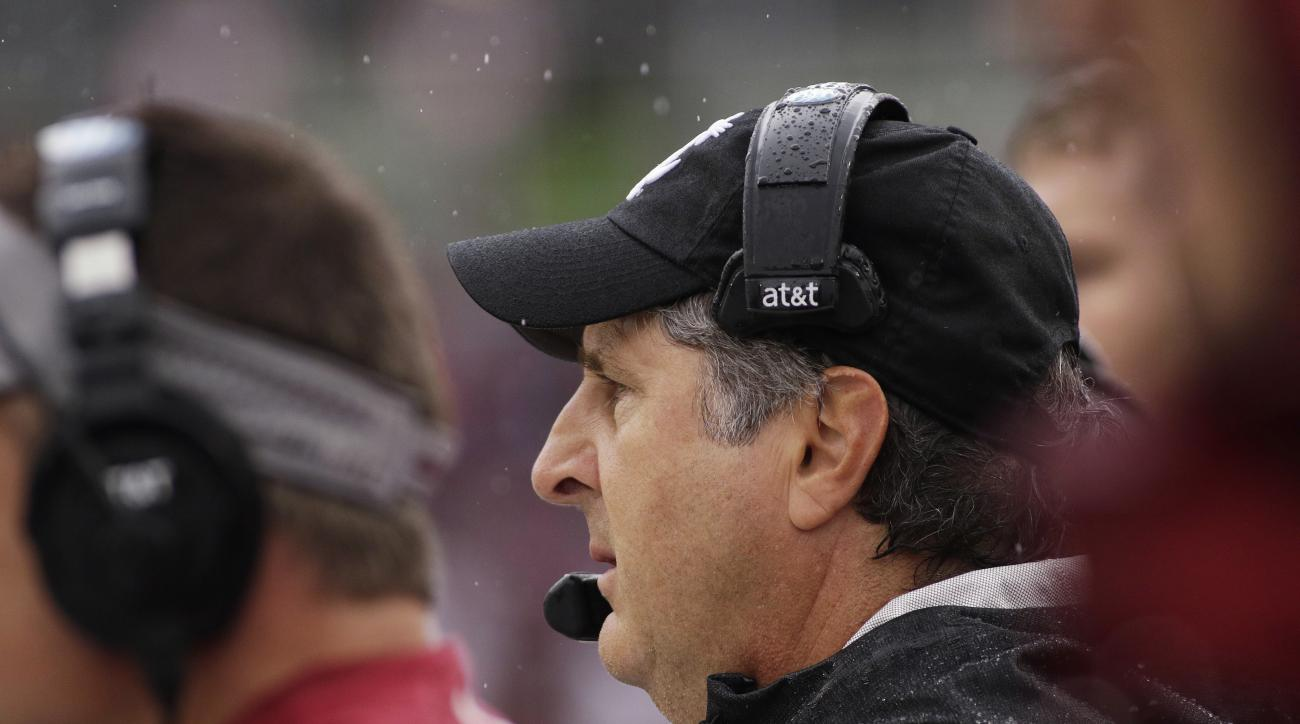 Washington State coach Mike Leach watches during the second half of an NCAA college football game against Portland State, Saturday, Sept. 5, 2015, in Pullman, Wash. Portland State won 24-17. (AP Photo/Young Kwak)