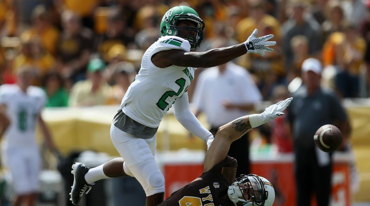 North Dakota defensive back Chris Brown breaks up a pass intended for Wyoming wide receiver Tanner Gentry during the first half of an NCAA college football game Saturday, Sept. 5, 2015, in Laramie, Wyo. (AP Photo/Blaine McCartney)