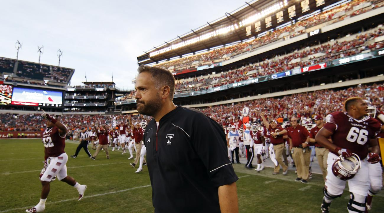 Temple head coach Matt Rhule walks onto the field after their 27-10 win over Penn State in an NCAA college football game, Saturday, Sept. 5, 2015, in Philadelphia. (AP Photo/Matt Slocum)