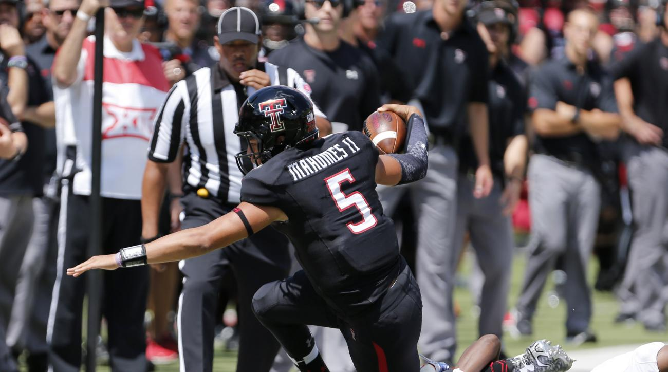 Texas Tech quarterback Patrick Mahomes (5) is tackled by Sam Houston State's Mikell Everette during an NCAA college football game Saturday, Sept. 5, 2015, in Lubbock, Texas. (Mark Rogers/Lubbock Avalanche-Journal via AP) ALL LOCAL TELEVISION OUT; MANDATOR