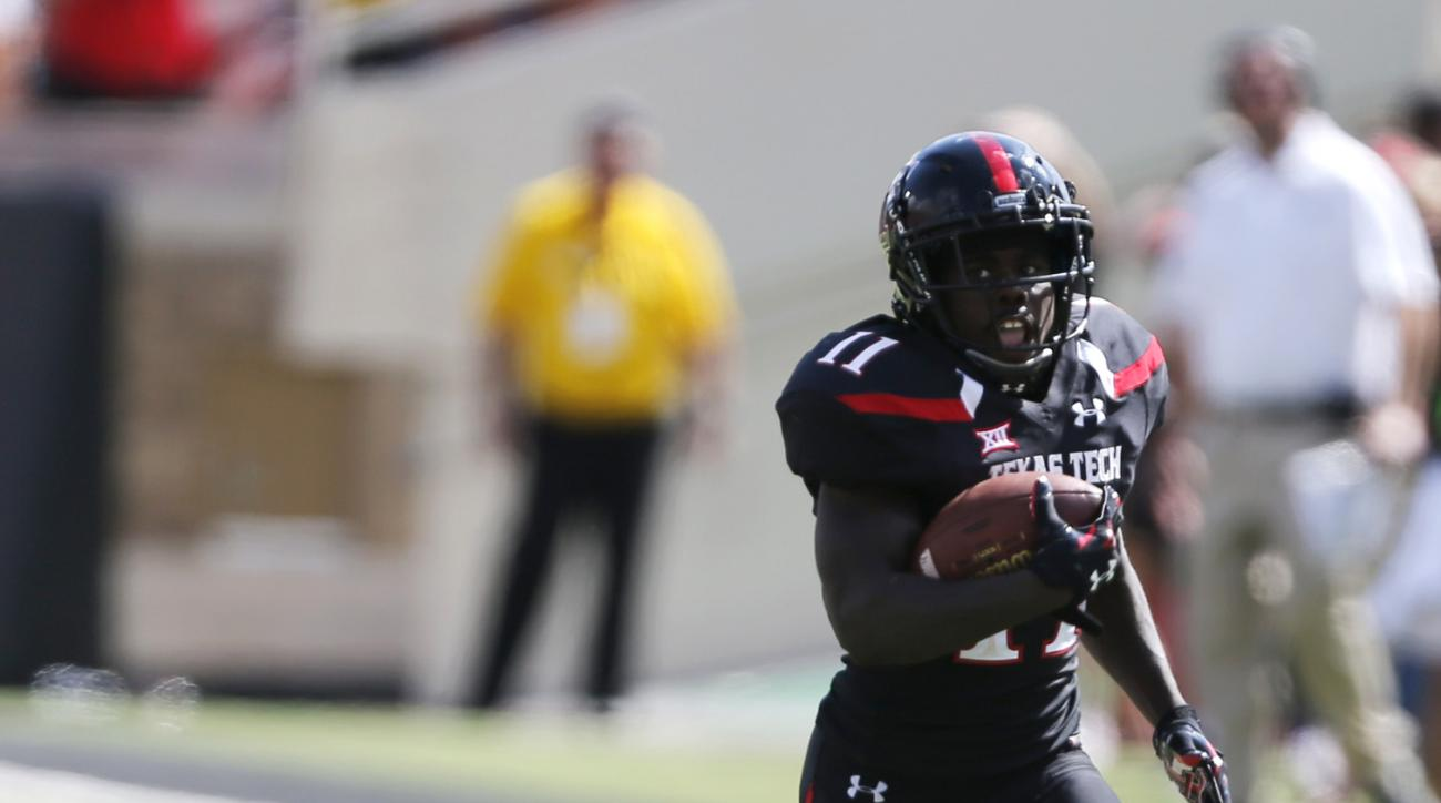Texas Tech's Jakeem Grant makes a touchdown run during an NCAA college football game against Sam Houston State, Saturday, Sept. 5, 2015, in Lubbock, Texas. (Mark Rogers/Lubbock Avalanche-Journal via AP) ALL LOCAL TELEVISION OUT; MANDATORY CREDIT