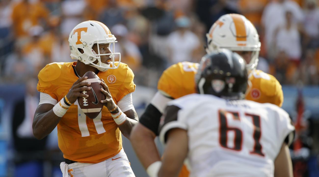 Tennessee quarterback Joshua Dobbs (11) drops back to pass as offensive lineman Brett Kendrick blocks Bowling Green defensive lineman Terrance Bush (61) in the first half of an NCAA college football game Saturday, Sept. 5, 2015, in Nashville, Tenn. (AP Ph