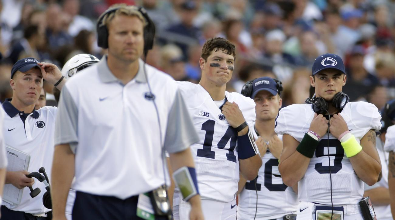 Penn State quarterbacks Christian Hackenberg (14), Billy Fessler (16) and Trace McSorley (9) watch from the sidelines during the second half of an NCAA college football game against Temple, Saturday, Sept. 5, 2015, in Philadelphia. Temple won 27-10. (AP P