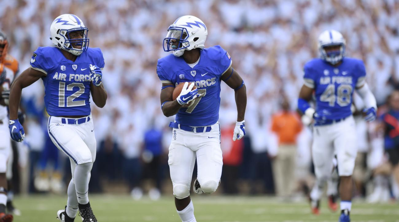 Air Force punt returner Garrett Brown looks over his shoulder during a 75-yard return for a touchdown during the second quarter of the Falcons' 63-7 win over Morgan State in an NCAA college football game in Air Force Academy, Colo., Saturday, Sept. 5, 201
